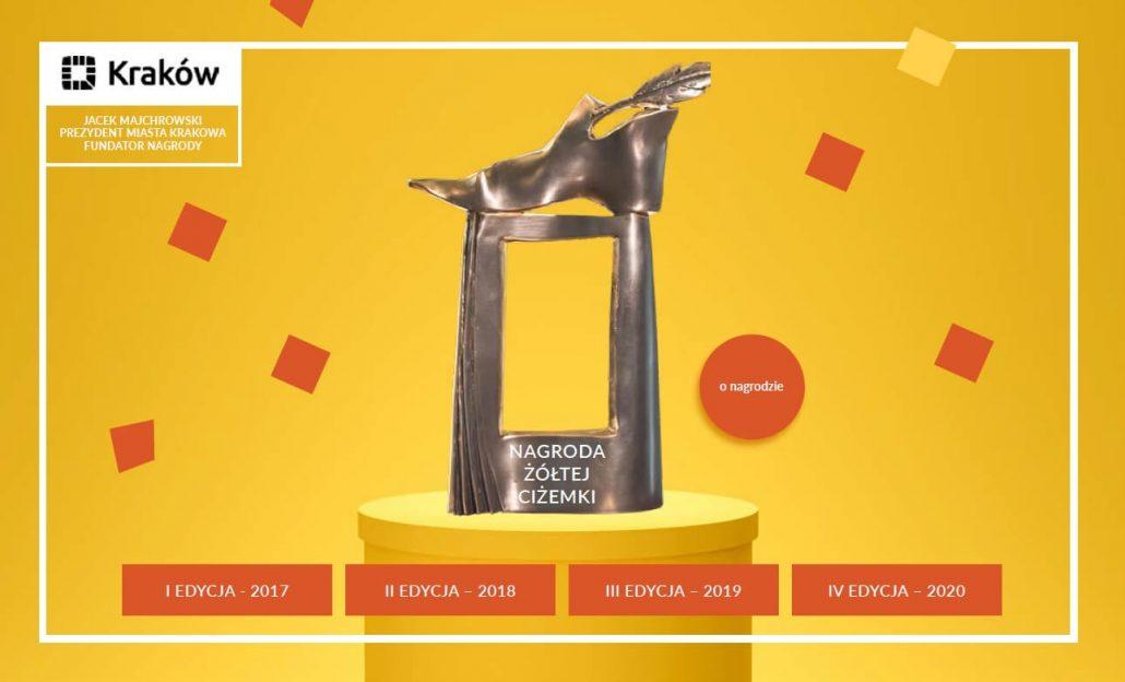 Na pierwszym planie statuetka nagrody,poniżej przyckiski do kolejnych edycji